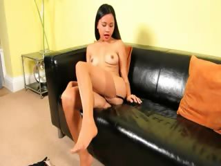tokyo pussy on black couch